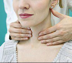 Image of a woman working with a throat specialist