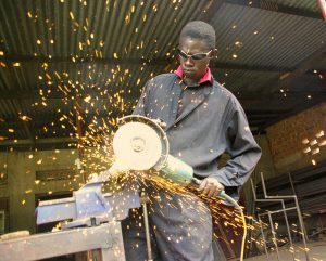 Image of a man working with an angle grinder and wondering if this could cause hearing loss
