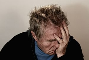 Image of a man feeling despair - probably because he has an ear infection