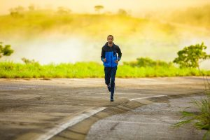 Image of a man with asthma running on a road