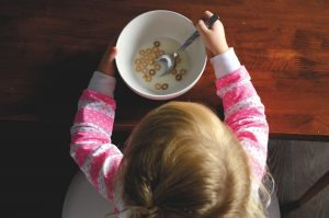 Image of a child and a bowl of cereal. Will the child have food allergies and need testing?